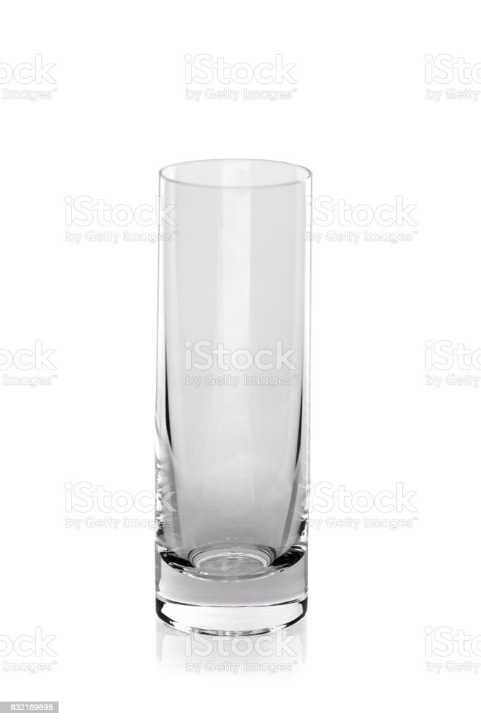 Empty glass isolated on a white background. Glass for vodka, cognac or whiskey shots. Kitchenware, glassware, dishware. stock photo