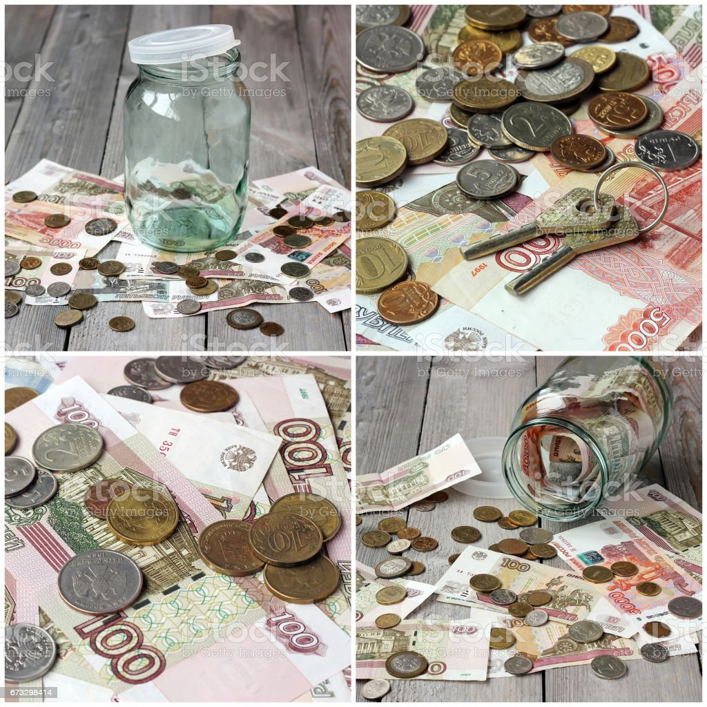 Empty glass jar and Russian money on the wooden floor. royalty-free stock photo