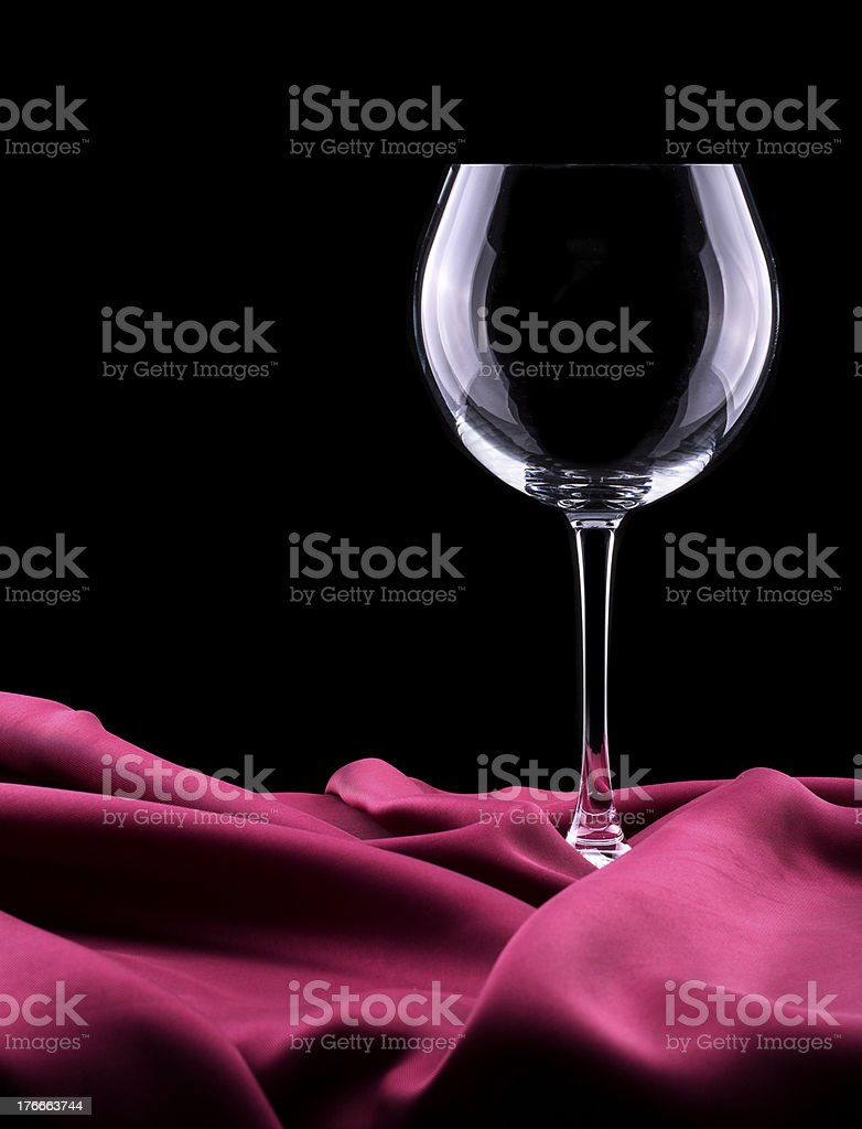 empty Glass  on red silk royalty-free stock photo