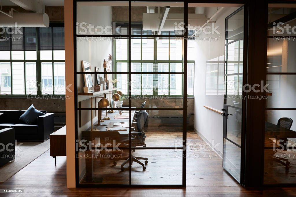 Empty glass walled office booth in a business place stock photo