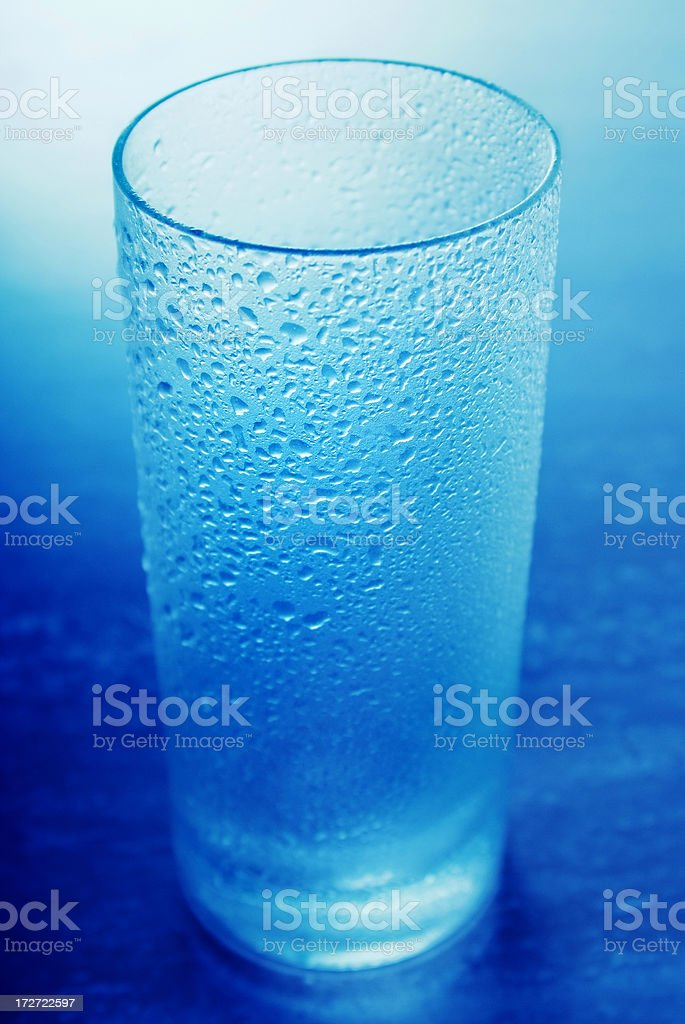 Empty glass with drops stock photo