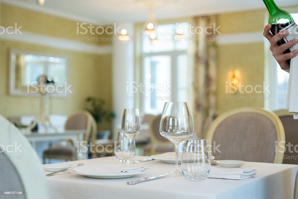 Empty glasses and plates installed in the restauran stock photo