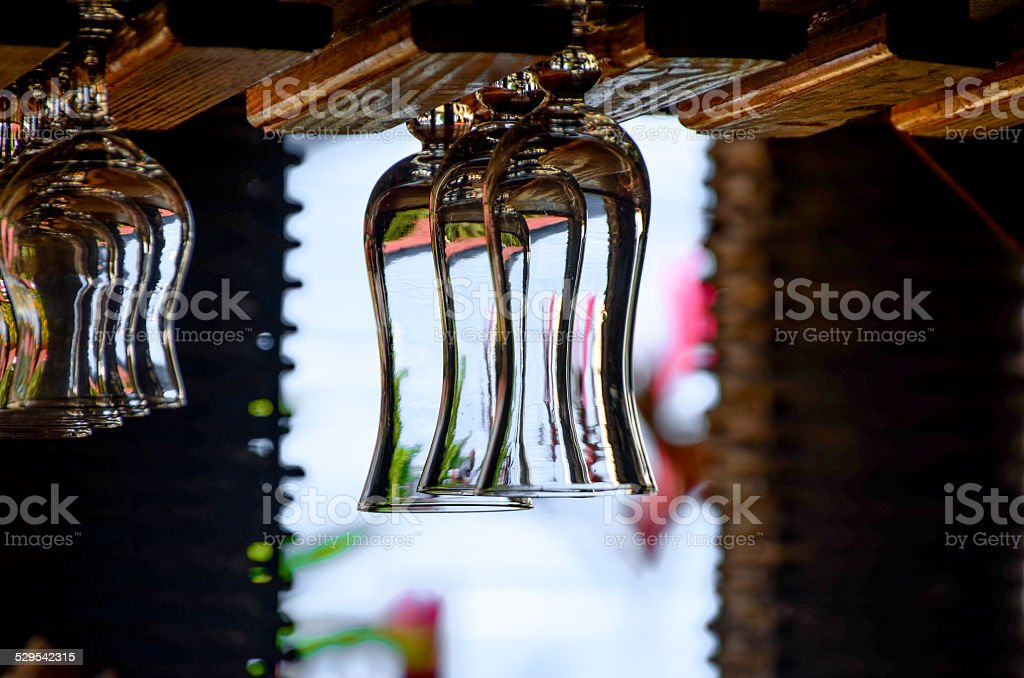 Empty glasses for alcohol beverage above a bar rack background stock photo