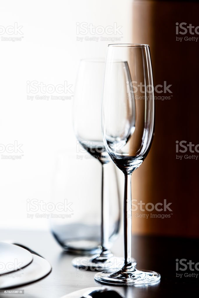 Empty glasses for champagne and wine are on the table in a row. royalty-free stock photo