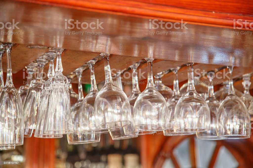 Empty glasses hanging over in restaurant bar stock photo