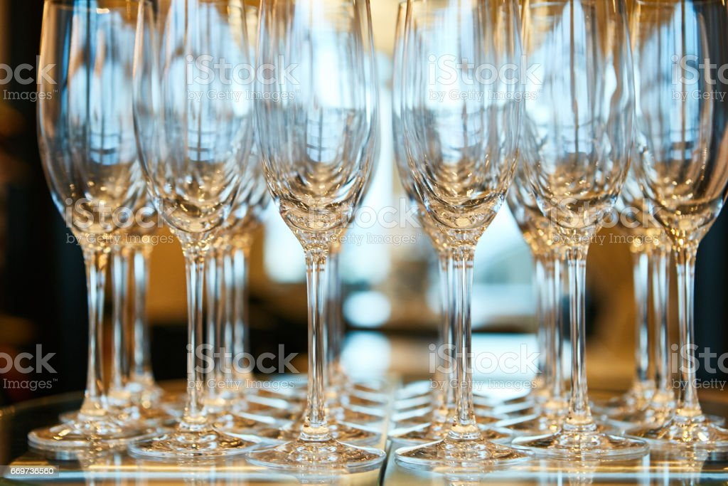 Empty glasses in restaurant natural light stock photo