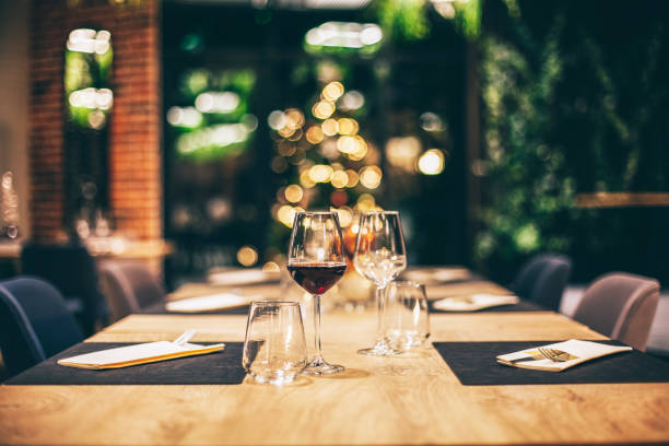 empty glasses in restaurant. table setting for christmas celebration - lepro stock pictures, royalty-free photos & images