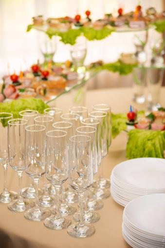 Empty glasses set, Elegant table setting for a festive dinner in the restaurant. Snacks on the buffet table