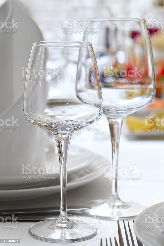 Empty glasses set in restaurant royalty-free stock photo