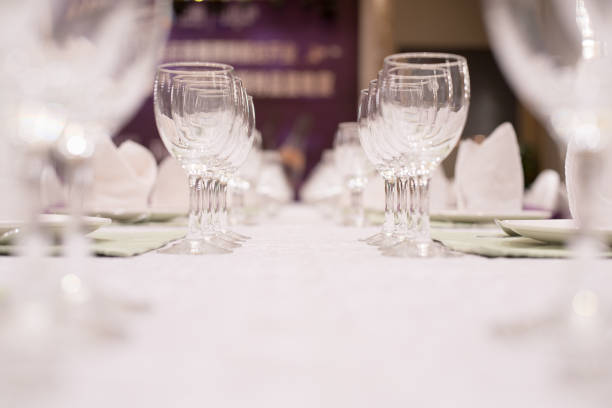 empty glasses set in restaurant - sport set competition round stock photos and pictures