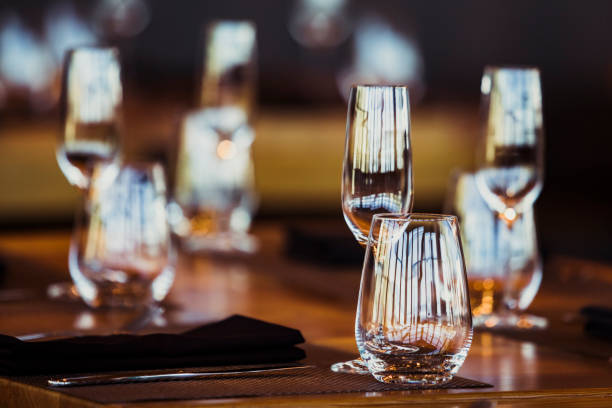 Empty glasses set up in restaurant. stock photo