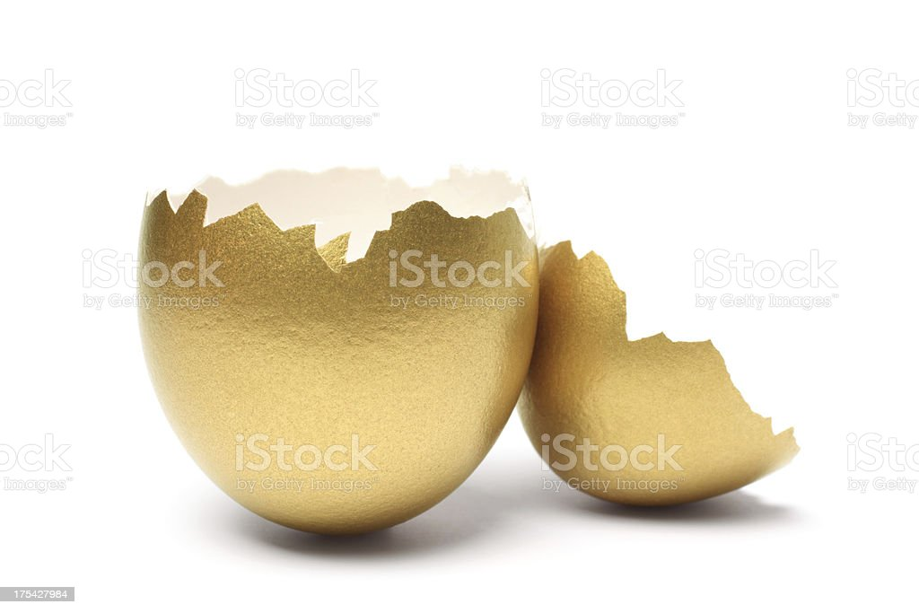 Empty Gold Egg Shell on White Background stock photo