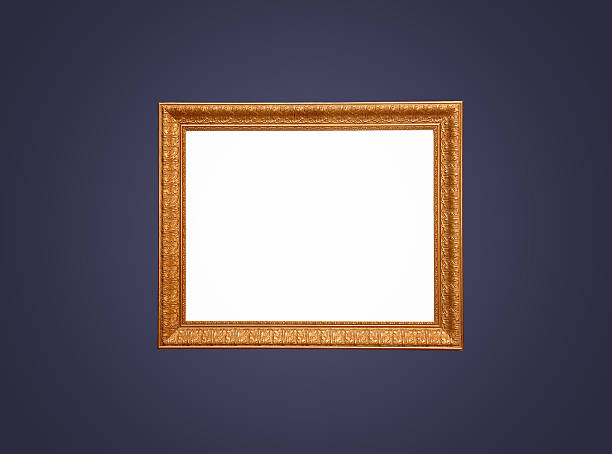 Empty gold frame on blue wall stock photo
