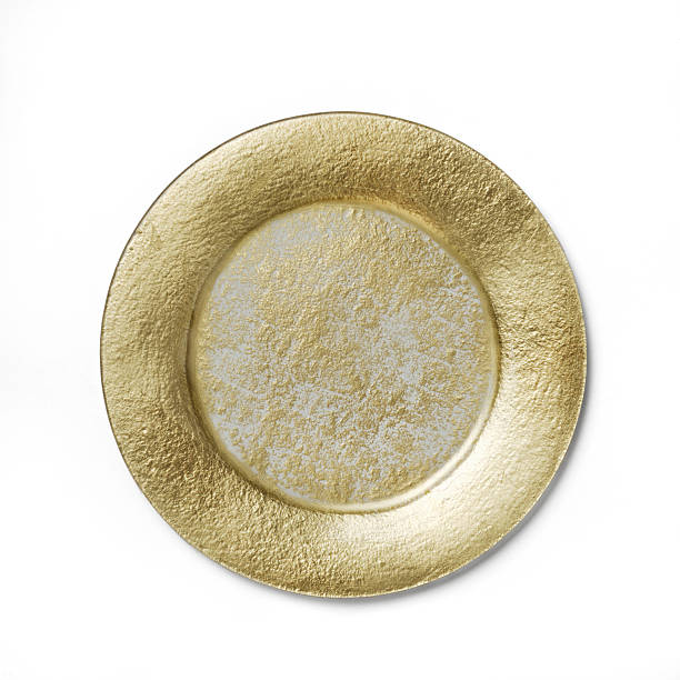 Empty golden dinner plate on a white background stock photo