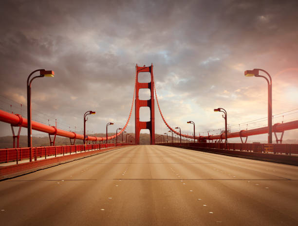 Empty Golden Gate Bridge Golden Gate Bridge in San Francisco without traffic in sunset light golden gate bridge stock pictures, royalty-free photos & images