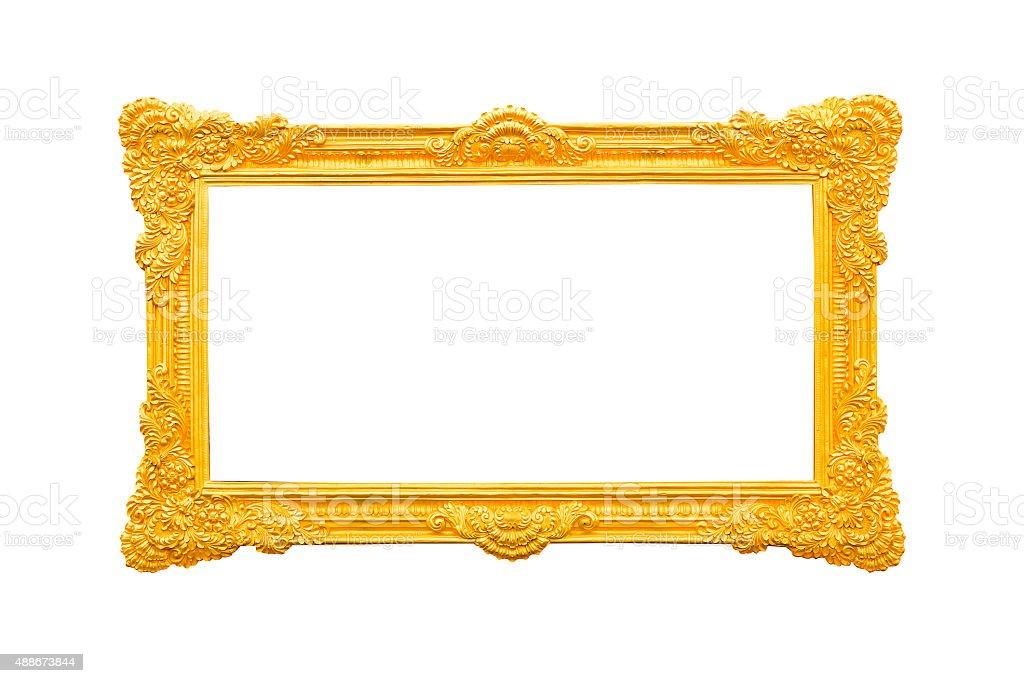 Empty golden vintage frame isolated on white background stock photo