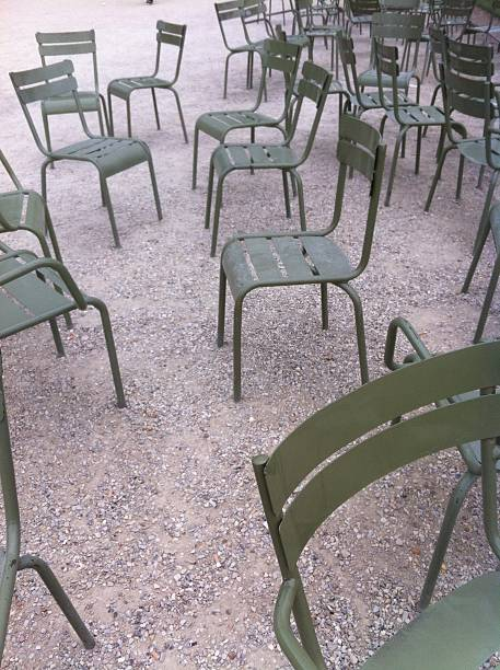 empty green chairs - defection stock photos and pictures
