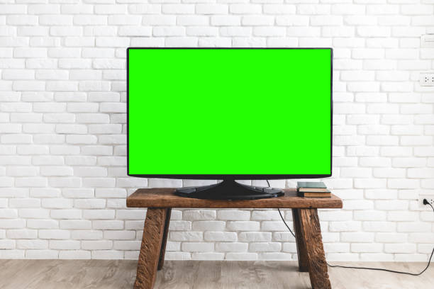 Modern Television With Chroma Green Screen And Brick Wall