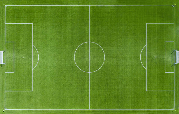 Empty Green soccer football pitch Aerial View Aerial view of Empty Green football pitch - soccer game. soccer field stock pictures, royalty-free photos & images