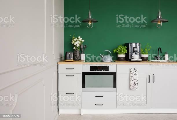 Empty green wall with copy space in elegant kitchen with white and picture id1095377750?b=1&k=6&m=1095377750&s=612x612&h=aq  t27glyihtpe dxqtzcm u n4lakjfjxrhd4  yk=