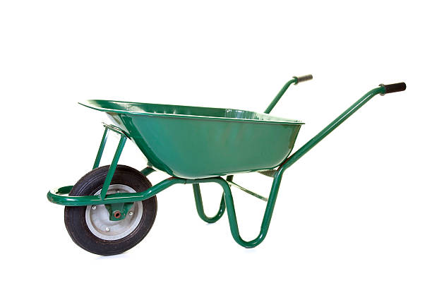 empty green wheelbarrow - kruiwagen stockfoto's en -beelden