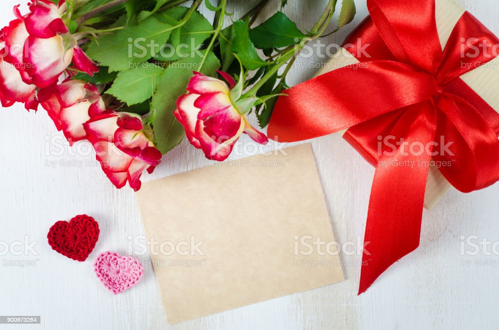 Empty greeting card, red roses and gift box stock photo