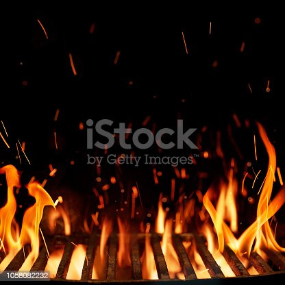 Empty grill grid with fire isolated on black background with copy space
