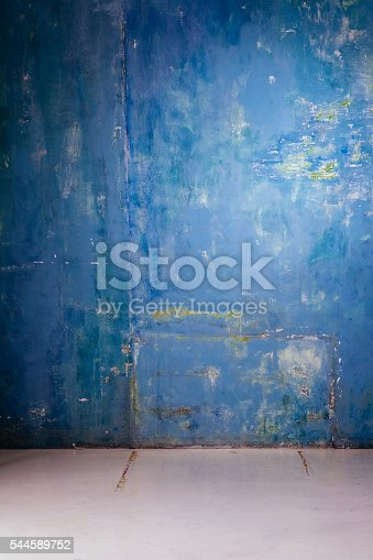 1062261710istockphoto Empty grunge room with floor and concrete wall 544589752