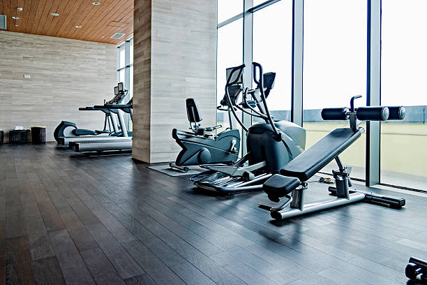 empty gym room - health club stock photos and pictures