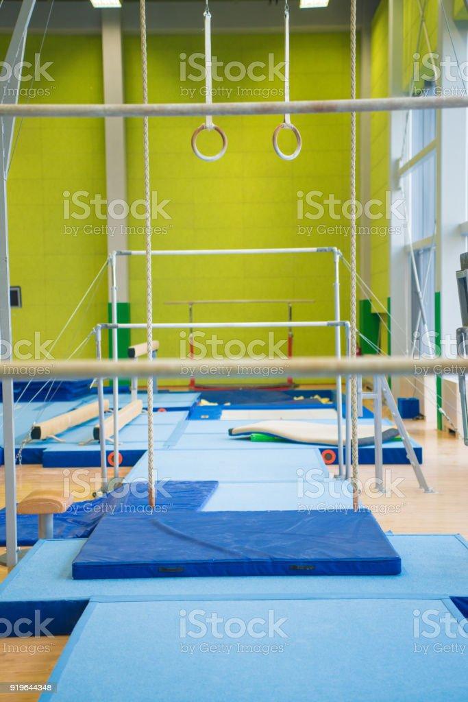 Empty Gym With Gymnastics Equipment.