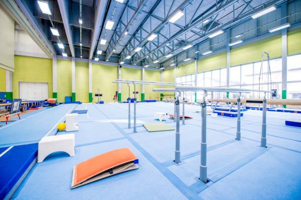 empty gymnastics gym - horizontal bar stock photos and pictures