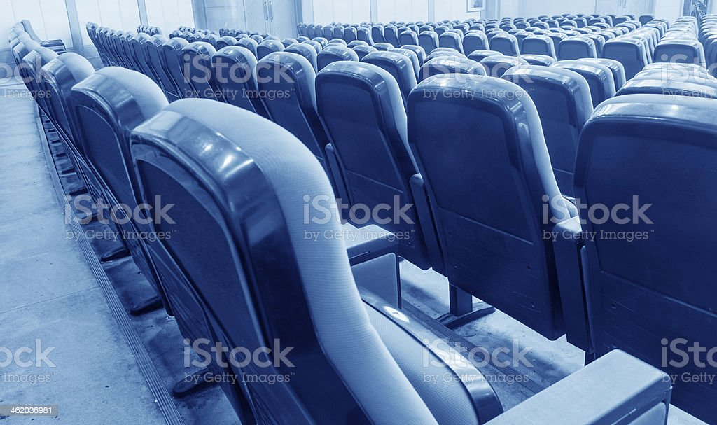 Empty hall for presentation with red armchairs stock photo