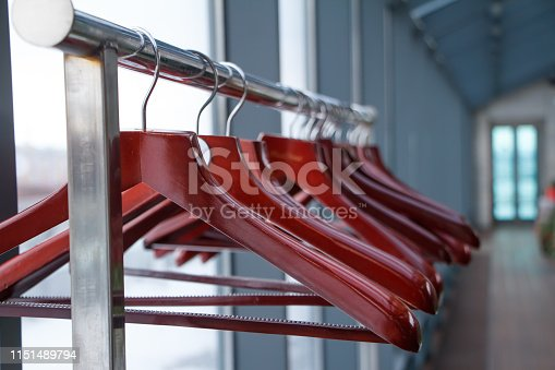 Empty hangers in store, sale is over, wardrobe in a restaurant or cafe, soft focus