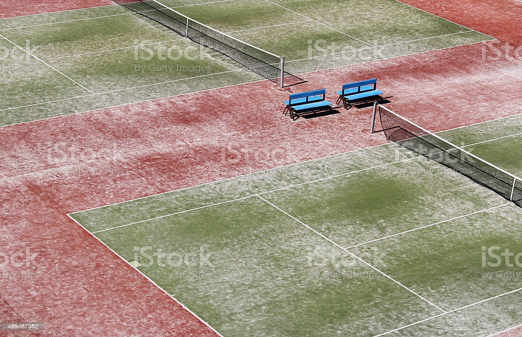 Empty hard green tennis court with net stock photo