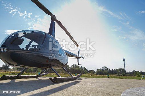 Empty helicopter with closed door grounded on airfield