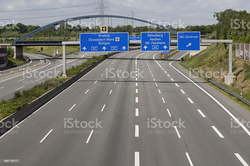 Empty highway and overhead signs. stock photo