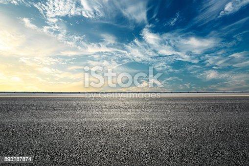 621693226istockphoto Empty highway asphalt road and beautiful sky sunset landscape 893287874