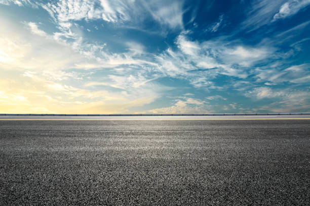 Empty highway asphalt road and beautiful sky sunset landscape Empty highway asphalt road and beautiful sky sunset natural landscape horizon over land stock pictures, royalty-free photos & images