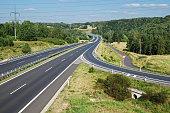 istock Empty highway with the slip road traffic sign give way 490130164