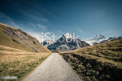 Grindelwald-First Hiking road with Swiss Alps mountain peaks.