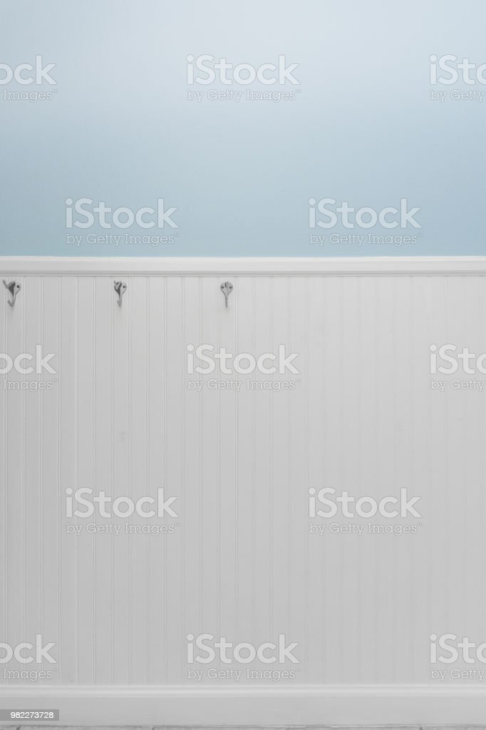 Empty hooks on white bead board or wainscot stock photo