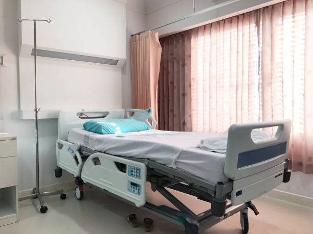 Empty hospital bed for patient stock photo