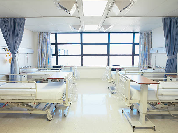 Empty hospital room with beds stock photo