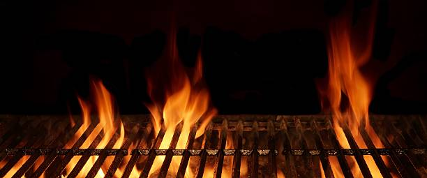 Empty Hot Flaming Charcoal Barbecue Grill With Bright Flame Isol stock photo