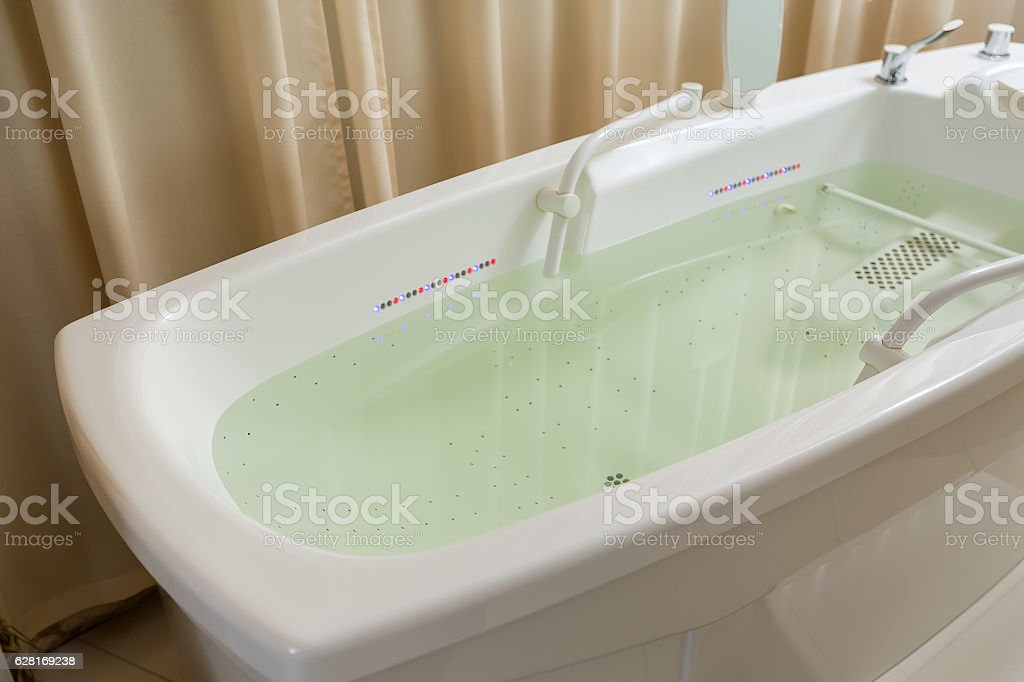 Empty jacuzzi, tub filled with water in the spa stock photo