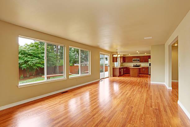 Empty house interior with new hardwood floor stock photo