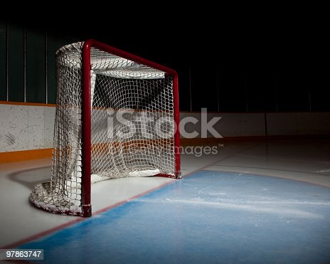 Empty ice hockey venue with the focus on the net