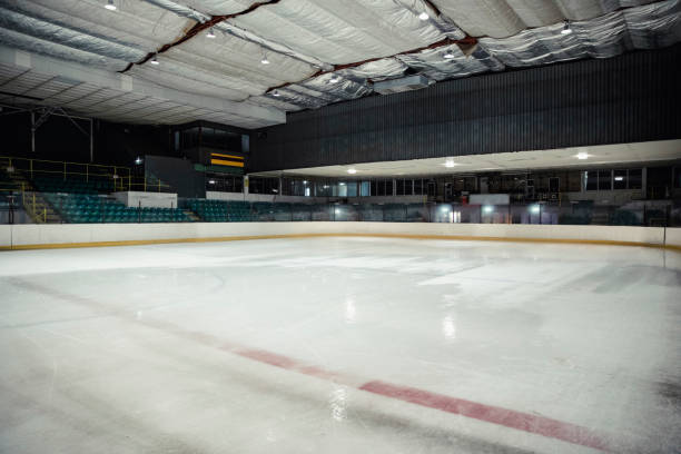 Empty Ice Rink Wide angle view of an interior of an empty ice rink. There are no people in the seats or on the ice. ice rink stock pictures, royalty-free photos & images
