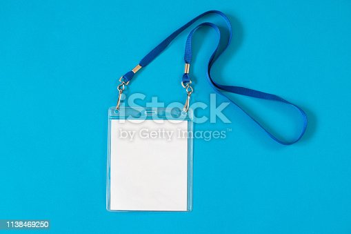 istock Empty ID card badge icon with blue belt on blue background 1138469250
