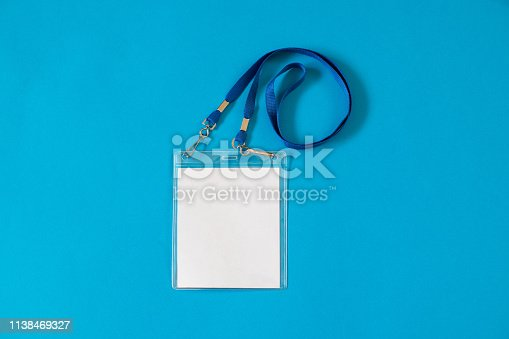 istock Empty ID card badge icon with blue belt on blue background 1138469327